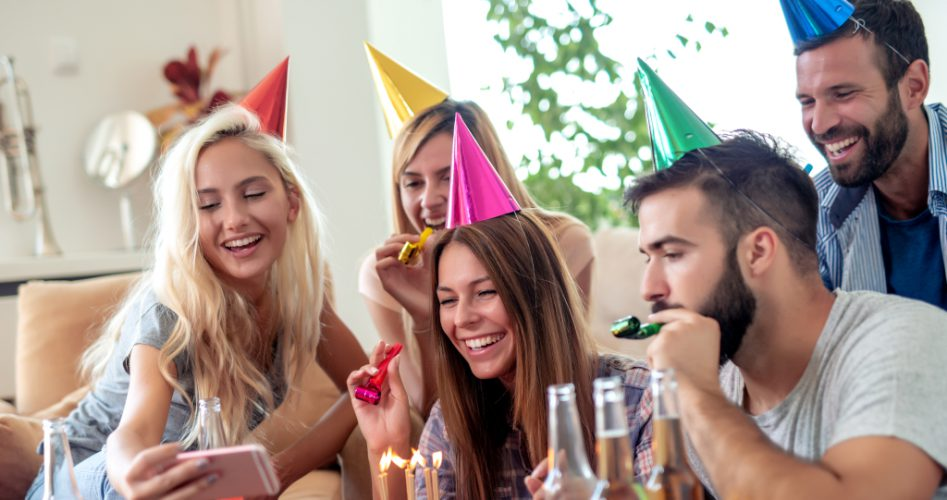 Young,Group,Of,Friends,Celebrating,Birthday,At,Home.